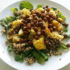 A warm quinoa chickpea, cauliflower and halloumi salad