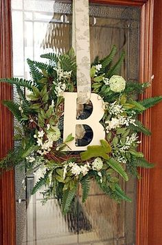 grapevine wreath with ferns and assorted white flowers...fresh and pretty for late winter!