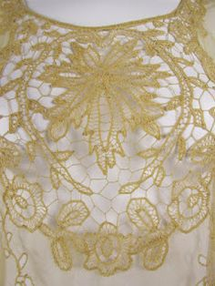 1920's Lace Dress. Lovely trailing flower motif with large lace inserts on to net. Detail