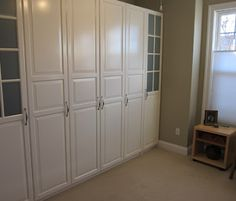 Bedroom features surrounding bookshelves bed recessed headboard