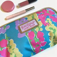 """Lily Pulitzer Cosmetic Make Up Bag Never used but does not have the tag still attached. Measures 8"""" X 4.5"""" X 2.25"""" and holds a surprising amount of stuff. Great to use for travel or to keep in a larger tote. Listing is for bag only, makeup is shown for styling purposes. Lilly Pulitzer Bags Cosmetic Bags & Cases"""