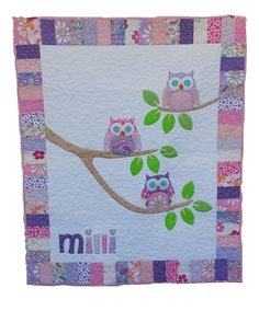 This sweet little quilt will be made for your little darling or little man. The finished size is 42 x 54 and can be customized with a name. To