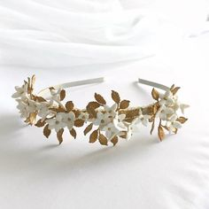 The Annabelle Headpiece's clusters of handcrafted flowers and golden leaves make for the most lovely crowning statement. This piece adds. Golden Leaves, Headpieces, Stud Earrings, Flowers, Jewelry, Fascinators, Bijoux, Studs, Stud Earring
