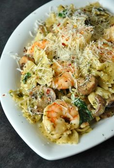 This Shrimp and Veggie Pesto Pasta features tender pasta swirled with pesto, veggies and perfectly sauteed shrimp. Everyone in my family loves this easy, yet impressive, weeknight dinner! Fish Recipes, Seafood Recipes, Cooking Recipes, Healthy Recipes, Recipies, Pasta Recipes For Dinner, Pesto Pasta Recipes, Pesto Shrimp Pasta, Pesto Pasta Dishes