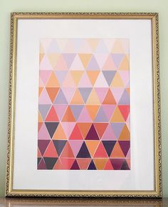 Paint Chip Triangle Art: Cut paint chips into triangles, and piece them together for a beautiful art piece.  Source: The Lovely Cupboard