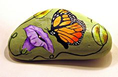 Butterfly and Flower Rock hand painted by getarock on Etsy, $20.00