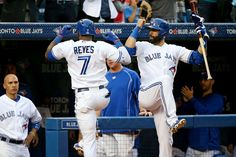 Blue Jay hooray -        Jose Reyes (7) of the Toronto Blue Jays is congratulated by teammate Jose Bautista (right) after hitting a two-run home run in the third inning of a game against the Houston Astros on June 5 at Rogers Centre in Toronto. The Blue Jays won 6-2.  -  © Tom Szczerbowski/Getty Images