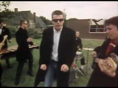 Madness - Baggy Trousers. I never did quite work out what one of them did in the band. Danced, I think.