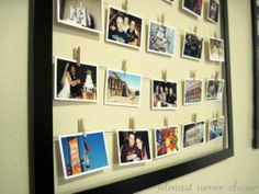 I like this, framing photos that are hung on a clothesline so you can keep switching them out yet still have it look clean