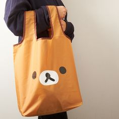 Life is stressful, what with work, school, and the myriad of other daily responsibilities we all have. That's why feel-good characters like Rilakkuma can be just the thing to perk you up and brighten your day, no matter how bad or gloomy it may be! This eco shopping bag features Rilakkuma's face on the front, and a zipper and tail design along with the logo on the back. When not in use, it can be rolled up for easy storage. Take it to the grocery store, the mall, or wherever else your ...