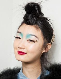 On the Catwalk: Manish Arora    How: Forget the blue brows, but moving your dolly bun forward makes for an instant update and a statement look that's actually pretty wearable.    Wear with: A red lip and you're good to go.
