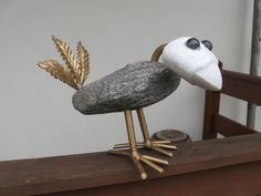 the bird made of granite, white marble and steel
