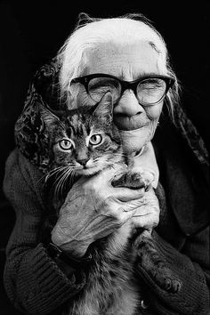 I love black and white photos. A sweet elderly woman and a cat. Perfect adorable!