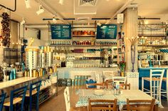 Fresh looking Greek restaurant, the blue tones and patterns create a lively space. GRECO Greek restaurant by Dan Troim Tel Aviv Israel Retail Interior, Restaurant Interior Design, Cafe Interior, Restaurant Interiors, Visual Merchandising, Greek Cafe, Cool Restaurant, Restaurant Ideas, Greek Restaurants
