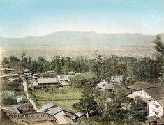 1880's, Kyoto. View on the city of Kyoto and the Nishiyama Mountain Range as seen from a viewing platform (展望台) at the Yoshimizu Hot Spring (吉水温泉) at Higashiyama. The path leads to Yasaka Jinja. On this image it does not yet have the electricity poles that would line it later. The scaffolding on the large building along the path suggests that it is under construction or undergoing maintenance . The green area in the middle of this photograph would in 1886  become Maruyama Park.