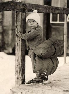 Dutch boy with a pillow strapped on his backside in order to soften the falling on ice while skating. The Netherlands, 1933.