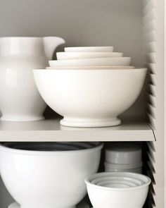 """Martha considered every corner of her kitchen in Bedford, New York, right down to the shelving supports. """"I like 'bird's beak' supports, an old carpentry style with notches that let shelves slide in and out,"""" Martha says. No holes, no hardware -- the look is streamlined. Martha Stewart Collection Whiteware large pitcher, macys.com."""