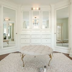 Ali Schwarz Design Group: Stunning walk-in closet with built-in cabinets, mirrored doors and tan linen round tufted ottoman with brass legs. Le Closet, Dressing Room Closet, White Closet, Dressing Room Design, Closet Bedroom, Walk In Closet, Dressing Rooms, Dressing Area, Master Closet