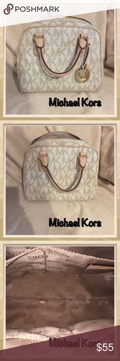 "Michael Kors small handbag Michael Kors small ivory and beige handbag. Good condition with minor wear and tear on handle and a small makeup stain inside. Approx 9"" wide by 7"" tall. Great summer or vacation bag! Michael Kors Bags Totes"