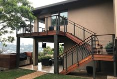 Modern Outdoor Stair Railing Designs And Ideas That Actually Make Sense treatments and care. You can get a visually similar effect by replacing the wood Outside Stair Railing, Exterior Stair Railing, Outdoor Stair Railing, Stair Railing Design, Glass Railing, Balcony Railing, Railings, Craftsman Exterior, Modern Exterior