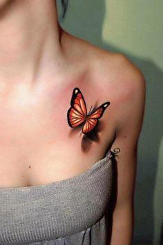Fresh orange butterfly tattoo chest