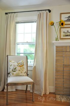 high cotton style drop cloth curtains on industrial pipe