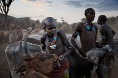 Picture of tribesmen in ethiopia bull jumping Randy Olson for National Geographic