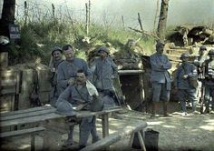 Haircuts in the trenches WWI, French soldiers.