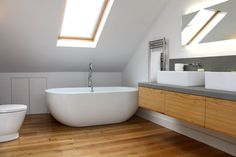 Bathroom timber flooring (and a beautiful bath) - Image from martynclarkearchitecture.com
