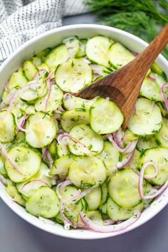 This Easy Cucumber Salad recipe is a family favorite recipe that people have been enjoying for ages Thinly sliced cucumbers and onion are tossed in a sweet and tangy vinaigrette for a classic side dish - food_drink Easy Cucumber Salad, Cucumber Recipes, Cucumber Salad Vinegar, Tomato Salad, Cucumbers In Vinegar, Recipes For Cucumbers, Recipes With Dill, Pickled Cucumbers And Onions, Cucumber Salad Dressing