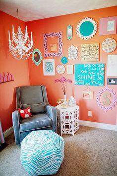 love the pouf ottoman & wall decor