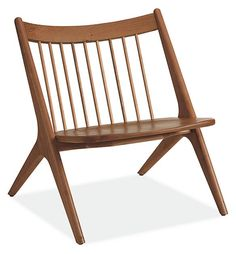 Inspired by the designs of renowned woodworker George Nakashima, the simple, sculpted profile of our Oskar chair is so striking, you'll want to place it center stage. Designed from solid wood with a contoured seat and angles crafted to fit the body, Oskar offers a roomy spot to rest.