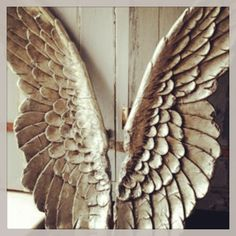 Antique French carved wings....