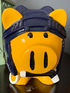 NHL Super Cute Buffalo Sabres Piggy Bank, Ceramic, Holding a Hockey Stick, Helmet is Blue, Pig is Yellow, Adorable, Kitschy, Kitsch. Cherry Blossom Bonsai Tree, Chocolate Photos, Cute Piggies, Buffalo Sabres, Hand Blown Glass, Piggy Bank, Kitsch, Nhl, Happy Shopping