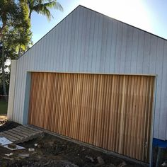 G A R A G E Vertical timber battens really make a feature of this custom garage door. Timber Garage Door, Cheap Garage Doors, Garage Door Colors, Custom Garage Doors, Garage Door Windows, Modern Garage Doors, Best Garage Doors, Garage Door Design, Custom Garages
