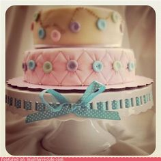 I am madly in love with those perfect tufted buttons. Also, how cute is that ribbon-laced cake stand?