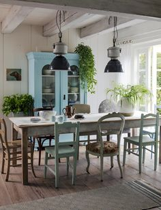 casual dining - great industrial lights + mismatched chairs
