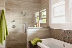"Updating a Cozy Craftsman | This Old House ""Limestone tile lines the master-bath walls and shower. The homeowner installed all the tile himself and made the vanity, medicine cabinets, and concrete counters."""