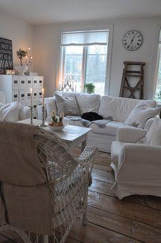 white slipcovers / natural wood floor