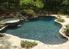 a facelift for a 22 year old this one needed it see how we transformed this, outdoor living, pool designs, spas, Natural freeform gunite swimming pool with new spillover spa mossrock waterfall tumbled stone patio landscaping Pool Plaster Colors, Gunite Swimming Pool, Pool Colors, Stock Tank Pool, Pool Builders, Patio Makeover, Pool Landscaping, Outdoor Living, Outdoor Spaces