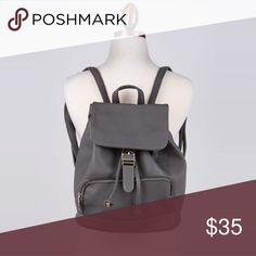 "Vegan leather buckle grey backpack Adorable backpack!! So perfect with any style. Oh and the color is perfect for any season. This grey buckle backpack a measurements are L: 11"" W: 11"" when open) H: 14"" Bags Backpacks"