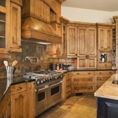 Decorate your kitchen with natural wood cabinets in a country style.