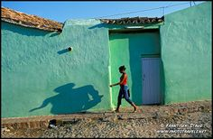 Photo of Young lady casting shadow - morning in Trinidad, Cuba photos