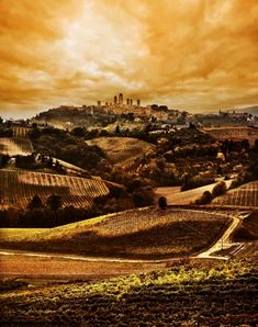 Tuscany landscape, dramatic Sunset with San Gimignano in the background gailmencini.com