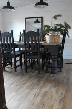 A beautiful rustic style dining room table with black chairs and base. The top is stained in a dark wax. Rustic Farmhouse Style