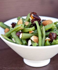 Clean Eating Cranberry Green Bean Salad  Ingredients:  1 pound fresh green beans, washed, trimmed and cut into bite-size pieces 1/3 cup dried cranberries, fruit juice sweetened 1/2 cup chopped almonds Directions:  Bring a large pot of water to boil. Pour the cut and cleaned beans into the water and set a timer for 5 minutes. When the timer goes off, simply drain the beans quickly and allow to cool. Combine with the cranberries and almonds and serve with dressing.