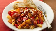 Easily enhance jarred pasta sauce with Italian sausages, garlic, peppers and onion.