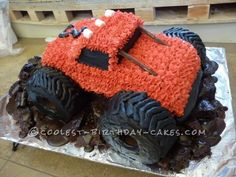 My husband and I worked together on this muddy Monster Truck birthday cake. We used the Wilton Race Car pan for the car body, following the instructio...