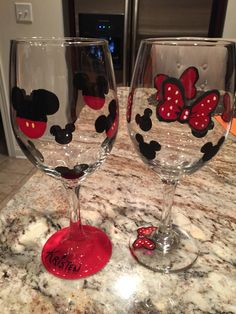Disney Mickey pants and Minnie bows hand painted wine glasses...his and hers!