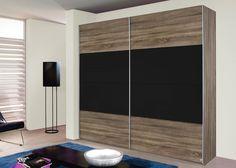 Schrank Quadra 226,0 cm Eiche Havanna Schwarz 8533. Buy now at https://www.moebel-wohnbar.de/schwebetuerenschrank-quadra-226-0-cm-eiche-havanna-glas-schwarz-8533.html